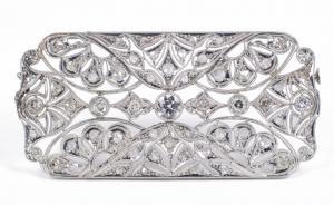 Broche antique Art Déco en platine avec diamants taille brillant et rosettes