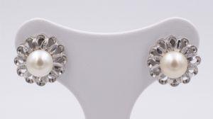 Boucles d'oreilles en or blanc et perles 50 ans