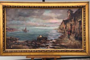 Peinture à l'huile sur toile représentant un paysage marin signé.