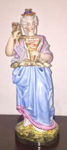 Veilleuse tisaniera figurée en porcelaine polychrome en forme de dame avec un chien.Modèle Jacob Petit.France.38 cm.